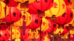 Chinese New Year red and yellow paper lanterns in the temple in Penang, Malaysia - stock footage