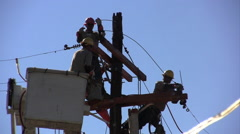 3 construction guys working on an electric pole Stock Footage