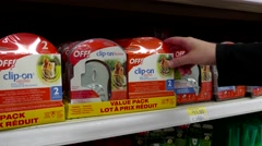 Woman buying Off clip on value pack inside Walmart store Stock Footage