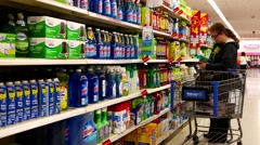 Woman buying cleaning product inside Walmart store Stock Footage