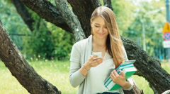 Close up portrait young student 20 years old using cell phone - stock footage