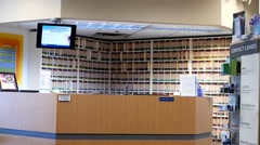 Motion of optical clinic full of patient medical records on bookshelf Stock Footage