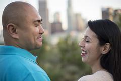 Latino Couple Looking at Los Angeles - stock photo