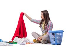 Woman tired after doing laundry isolated on white Stock Photos