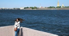 Girl on the Palace embankment of Neva, Peter and Paul fortress, Saint Petersburg Stock Footage