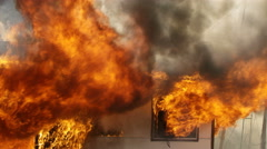 House on fire burning in slow motion Stock Footage