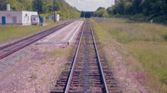Moving Railroad tracks. Train passing through countryside Stock Footage