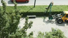 Public excavator mounted Hedge trimmer in Malmo Stock Footage