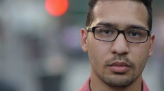 Young Latino Hispanic man in New York City face portrait angry serious - stock footage