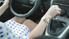 Girl or woman in polka-dot dress is driving. - stock footage