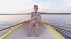 4k woman rows a boat Stock Footage