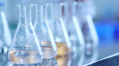 Flasks with chemical in laboratory Stock Footage