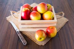 Apples in a wooden crate. Stock Photos