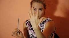 Closeup beautiful woman chewing gum and makes a manicure. Woman with bad manners Stock Footage