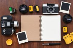 Blank notebook with photo film, photo frames and camera - stock photo