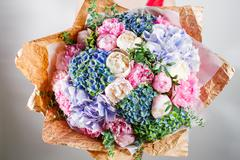 Flower composition with hydrangea and peonies. Color pink, green, lavander, blue Stock Photos