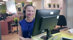 Call centre agent working in bright office. Helpline support - stock footage
