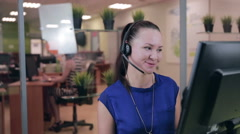 Smiling call centre operator, agent working in a bright helpline support Stock Footage