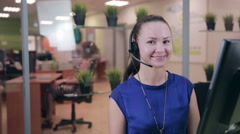 Smiling call centre operator, agent working in a bright helpline support - stock footage