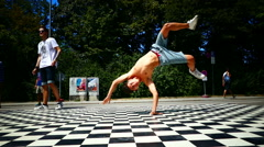 Teenage young boy performing practicing acrobatic on floor - stock footage