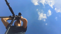 Videographer on the camera's shooting landscapes. The camera and tripod. - stock footage