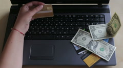 Woman makes card payments online Stock Footage