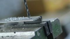 Worker drilling metal at workshop Stock Footage