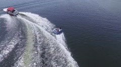 4k aerial boat almost ejects tuber over wave Stock Footage
