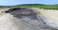 Mud Volcano Bubbling, With Muddy Water Coming Out Of It Stock Footage