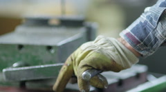 Worker drilling metal at workshop Stock Footage