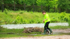 Sister And Small Brother Playing Near River Stock Footage
