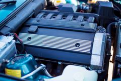 Close-up photo of old motor with intake manifold - stock photo