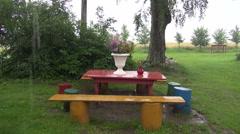 Rain falling on table outdoors Stock Footage
