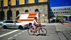 Ambulance truck passing crosswalk Munich Germany Europe Stock Footage