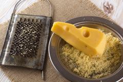 Grated cheese in a metal bowl Stock Photos