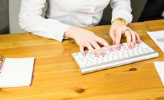 Hands of an office woman typing Stock Photos