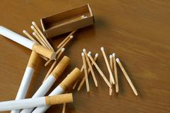 Matchstick matchbox and cigarette Stock Photos