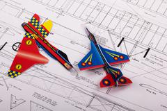 Making toy aircraft ready to fly with instructions - stock photo