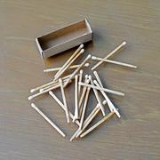 Matchstick and matchbox Stock Photos