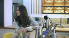 Woman sitting in cafe with cappuccino - stock footage