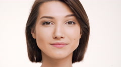 Portrait of young pretty girl playing mimicry and smiling Stock Footage