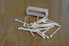 matchstick and matchbox - stock photo
