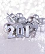 2017 year silver figures and silvery Christmas decorations Stock Photos