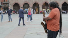 Street Saxophonist in Piazza Maggiore, Bologna Stock Footage