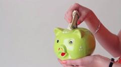 Lady's hand holding money box. Stock Footage
