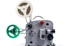 Retro old reel movie projector for cinema. With clipping path. A reels of mot - stock photo