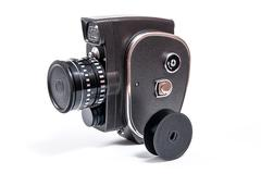 Vintage movie camera isolated on white - stock photo
