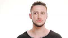 Portrait of young handsome man with shifty eyes Stock Footage