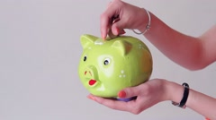 Girl's hand with money box. Stock Footage