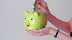 Girl's hand holding money box. Stock Footage